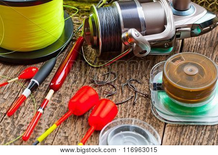 Items for sport fishing laid out on a table in the composition