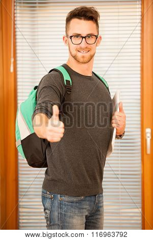 Adult Man Representing Lifelong Learning. Man With School Bag Showing Thumb Up As A Gesture Of Happi