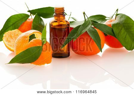 Essential Oil Of Orange Mandarin Citrus Fruit In Little Bottle Decorated With Mandarin Peel.