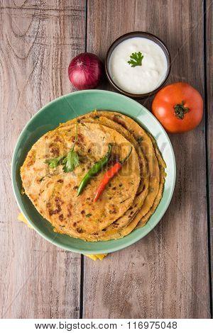 Traditional Indian bread - Aloo paratha or aalu parotha, potato stuffed bread. served with tomato ke