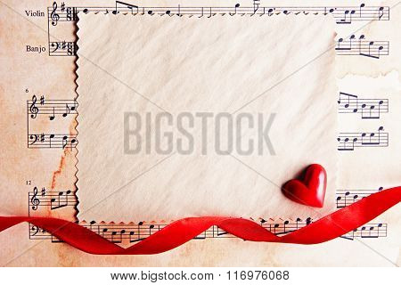 Blank present Valentine card on music sheet background