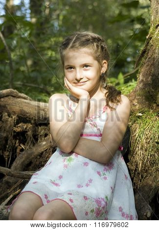 girl sits in wood