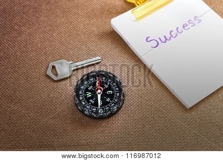 Compass With Text Success In Business Concept And Key Background