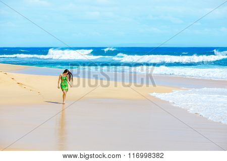Beautiful Teen Girl In Green Dress Walking Along Hawaiian Beach