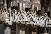 Buffalo jaws hanging at Tongkonan traditional houses in Kete Kesu village. Tana Toraja Sulawesi. Indonesia poster