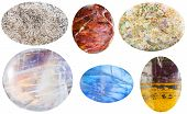 macro shooting of collection natural stones - anhydrite sunstone moss agate moonstone adularia jaspillite cabochon gem stones isolated on white background poster