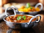indian butter chicken curry in balti dish shot with selective focus poster