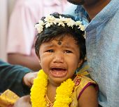 Baby girl crying after karna vedha events. Traditional Indian Hindus ear piercing ceremony. India special rituals. poster
