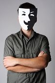 man in theater black and white smiling mask standing with crossed hands poster