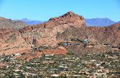 Aerial view of expensive real estate along the base of the south side of Camelback Mountain in Phoenix Arizona poster