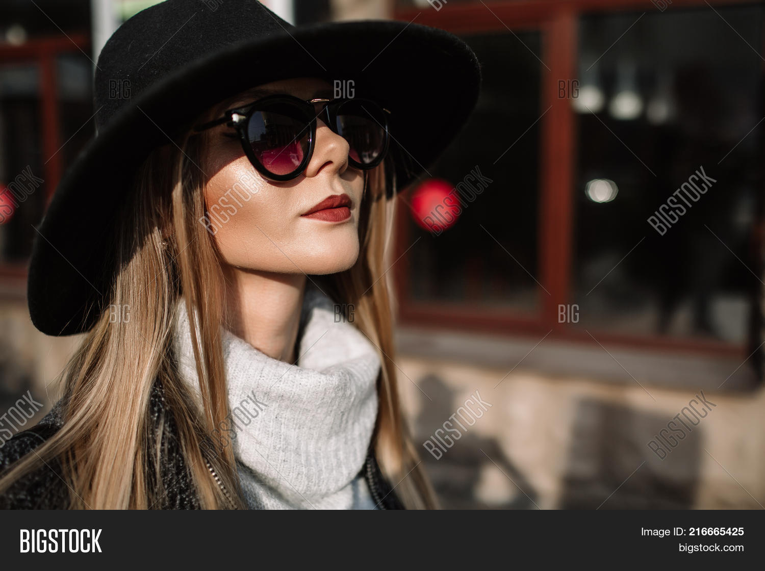 Portrait Of A Young Beautiful Fashionable Girl Wearing Sunglasses. Model In  A Stylish Black Hat 93063a52120