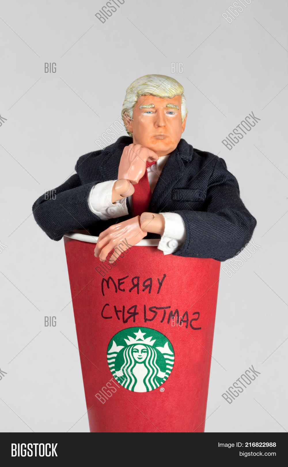 donald trump caricature action figure coming out of a starbucks coffee cup with merry christmas written - Starbucks Merry Christmas