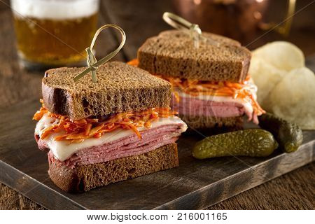 Smoked meat on rye sandwich with melted swiss cheese and coleslaw tossed in russian dressing.