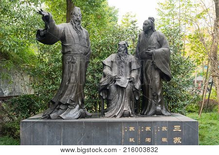 Chengdu, China - Nov 28, 2017: BaoZhao chniese SuChe, SuXun and SuShi poets statues in HuanHuaXi public park.
