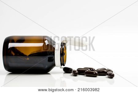 Multivitamins capsule pills for pregnant woman with amber bottle with blank label and copy space isolated on white background. Vitamins and supplements for hard working guy. Global healthcare concept