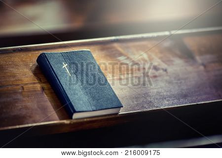 Book Holy Bible. Holy Bible On Old Wooden Church Table