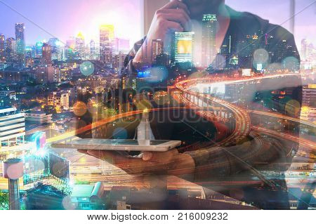 Double Exposure Of Man Or Male Hold Digital Wireless Tablet With Glowing Modern City Scenic