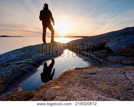 Tall Backpacker Watch Clear Sunny Daybreak Over Sea. Hiker  Hiker Enjoy Breathtaking Sunrise