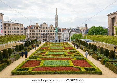 Brussels, Belgium - April 22, 2017: Tourists in scene of Brussels city from Kunstberg or Mont des Arts - Mount of the Arts with Town Hall and Equestrian monument of King Albert I