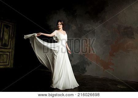 Beautiful Bride Portrait.Beautiful bride whirls her wedding dress.