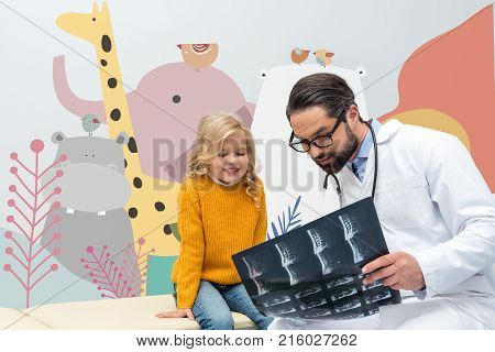 Pediatrist Showing X-ray To Girl