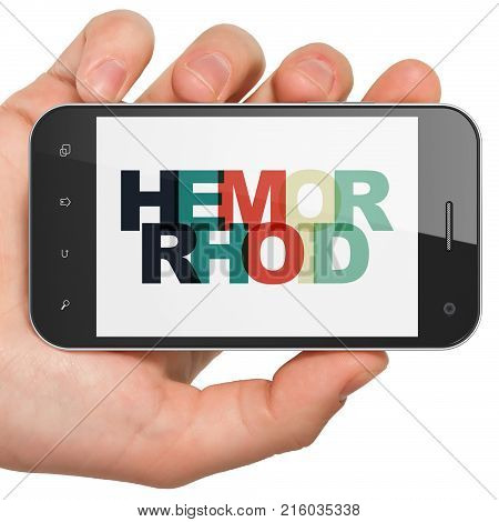 Healthcare concept: Hand Holding Smartphone with Painted multicolor text Hemorrhoid on display, 3D rendering
