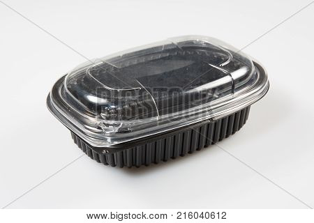 A Plastic Package With A Black Lid And A Transparent Lid