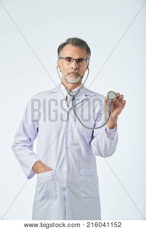 Portrait of therapeutist with stethoscope in hand