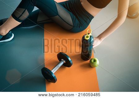 Fitness Woman With Healthy Workout Equipment On Gym Floor. Exercise And Body Build Up Concept. Beaut