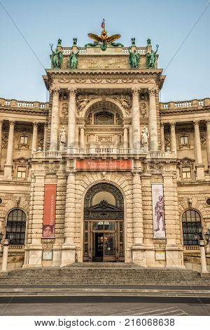 VIENNA, AUSTRIA - JULY 17, 2014: Entrance of the famous Vienna National Library from Heldenplatz in Vienna, Austria.