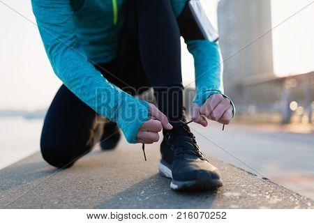 Runner trying running shoes getting ready for long run