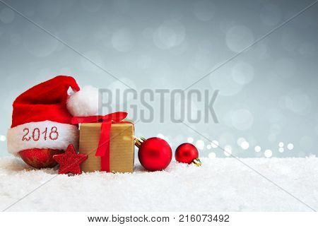Santa Claus hat and red christmas decoration isolated on gray background. Happy New 2018 Year background with Santa Claus hat.