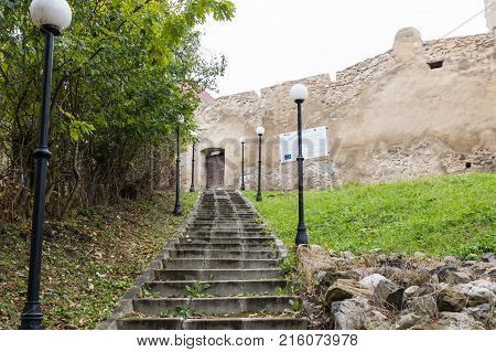 Near Sighisoara Romania October 08 2017 : The staircase leading to the fortress wall of the Rupea Citadel on the road between Sighisoara and Brasov in Romania