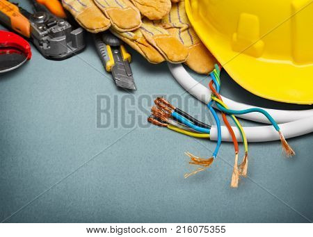 Electrician gloves tools activity yellow objects background