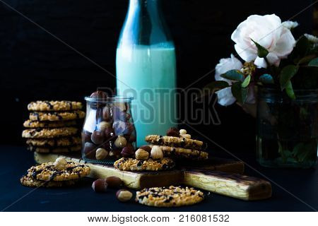 Cookies and milk. Chocolate chip cookies and a glass of milk. Vintage look. Tasty cookies and glass of milk on rustic wooden background. Food junk-food culinary baking and eating concept