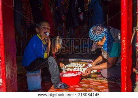 Making Kurut, Cheese Balls In Yurt