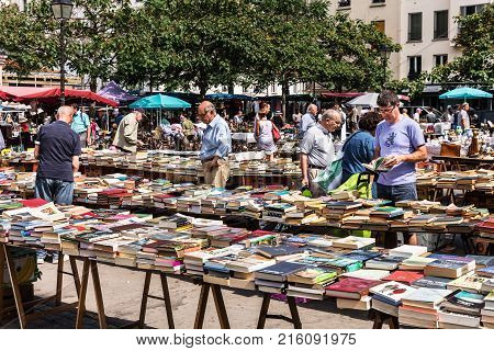 Paris France - Jule 09 2017: People choosing rare and used books at the historic flea Aligre Market (Marche d'Aligre) in the Bastille district.