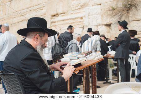 Jerusalem Israel - April 2017: An Orthodox Jew Reads The Talmud Near The Western Wall. The Western W