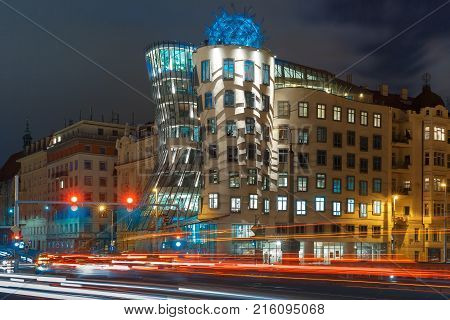 Prague, Czech Republic - December 23, 2015: The famous dancing house, also called Ginger nad Fred, at night in Prague, Czech Republic