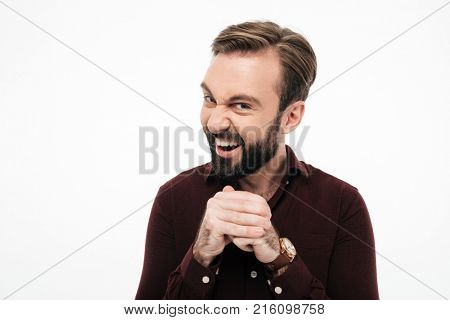 Portrait of a sneaky bearded man planning something isolated over white background