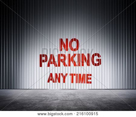 red inscription on metal fence which notifies about ban of parking