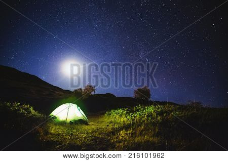 Scenic image of night sky over the peak Ushba. Location Samegrelo-Zemo Svaneti, country Georgia, Europe. Main Caucasian ridge. Astrophotography. Adventure vacations. Explore the beauty of earth.