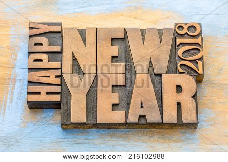 Happy New Year 2018 greeting card - word abstract t in vintage letterpress wood type blocks