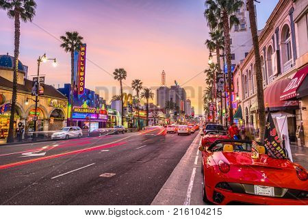 LOS ANGELES, CALIFORNIA - MARCH 1, 2016: Traffic on Hollywood Boulevard at dusk. The theater district is a famous tourist attraction.