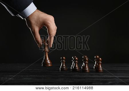 Man playing chess on table. Management concept