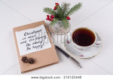 Merry Christmas greetings or wishes - Handwritten text with wishes on a napkin - Christmas is near and its coming Be merry Be happy