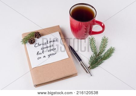 Merry Christmas greetings or wishes - Handwritten text with wishes on a napkin - Christmas comes but once in a year