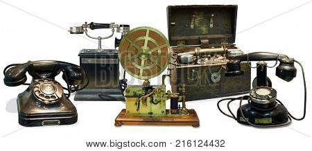 Old telephones, telegraph apparatus, portable telephone apparatus in wooden case isolated on white, collage