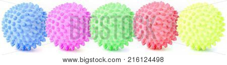 Five different spiky balls - toy for dogs isolated on white, collage