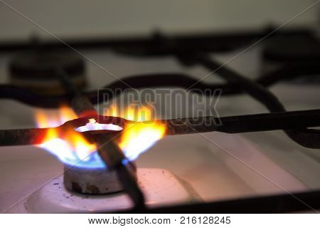 flames of gas burning from a kitchen gas stove